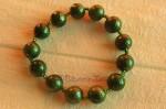 Z naší nabídky vybíráme: Zelený náramek s kuličkami na pružence - 50 Kč